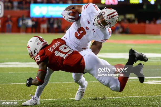 Defensive back Marquel Dismuke of the Nebraska Cornhuskers tackles running back Rachid Ibrahim of the Wisconsin Badgers at Memorial Stadium on...