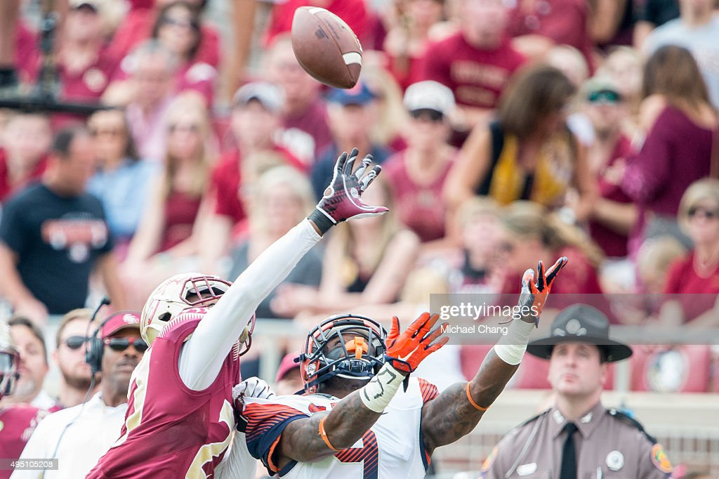 Defensive back Marquez White #27 of the Florida State Seminoles looks to break up a pass intended for wide receiver Brisly Estime #9 of the Syracuse Orange on October 31, 2015 at Doak Campbell Stadium in Tallahassee, FL.