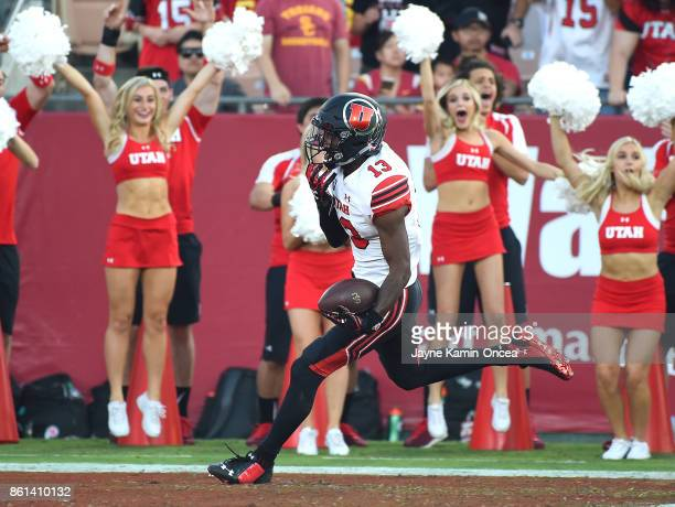 Defensive back Marquise Blair of the Utah Utes runs the ball into the end zone after an interception in the first quarter of the game against the USC...