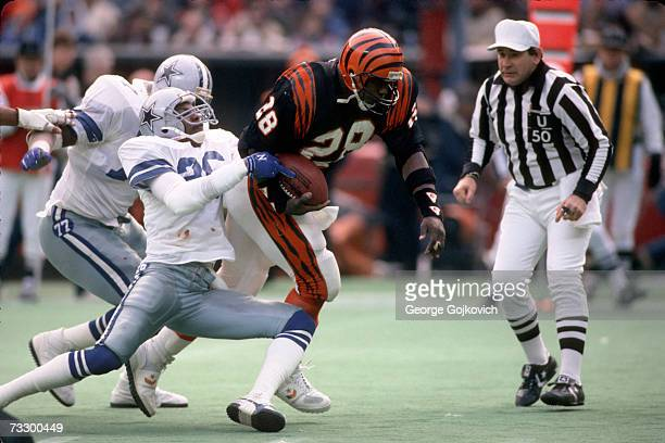 Defensive back Michael Downs of the Dallas Cowboys tackles running back Larry Kinnebrew of the Cincinnati Bengals at Riverfront Stadium on December 8...