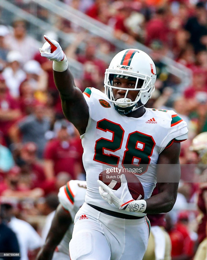 Defensive back Michael Jackson #28 of the Miami Hurricanes celebrates after an interception against the Florida State Seminoles during the first half of an NCAA football game at Doak S. Campbell Stadium on October 7, 2017 in Tallahassee, Florida.