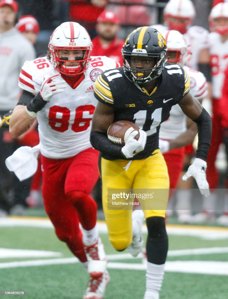 Defensive back Michael Ojemudia of the Iowa Hawkeyes runs back an ...