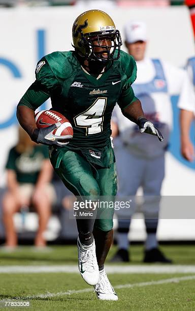 Defensive Back Mike Jenkins of the South Florida Bulls returns a kickoff during the game against the Cincinnati Bearcats on November 3, 2007 at...