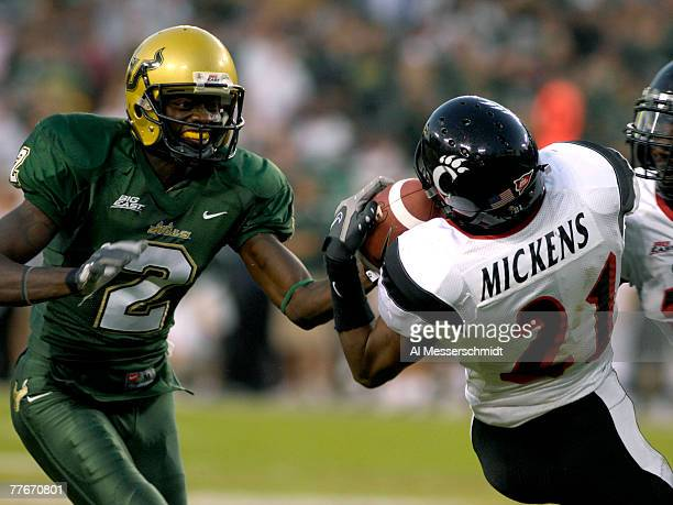 Defensive back Mike Mickens of the Cincinnati Bearcats attempts an interception against the University of South Florida Bulls at Raymond James...
