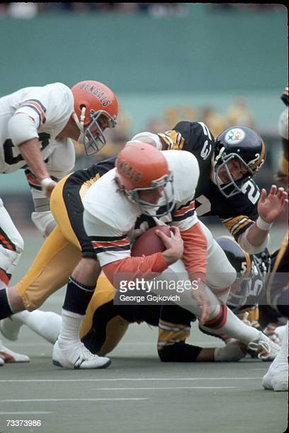 Defensive back Mike Wagner of the Pittsburgh Steelers tackles running back Stan Fritts of the Cincinnati Bengals at Three Rivers Stadium on October...