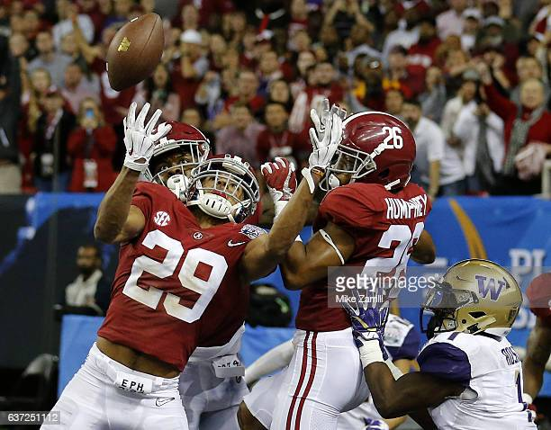 Defensive back Minkah Fitzpatrick of the Alabama Crimson Tide intercepts a pass in the fourth quarter in the 2016 CFP semifinal at the Peach Bowl at...