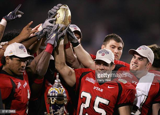 Defensive back Morgan Scalley of Utah holds the trophy with his team after defeating Pittsburgh 357 in the Tostito's Fiesta Bowl at the Sun Devil...