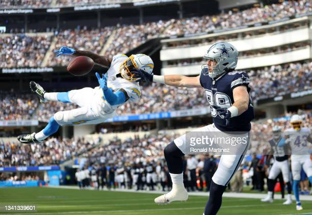 Defensive back Nasir Adderley of the Los Angeles Chargers breaks up a pass intended for tight end Blake Jarwin of the Dallas Cowboys during the...
