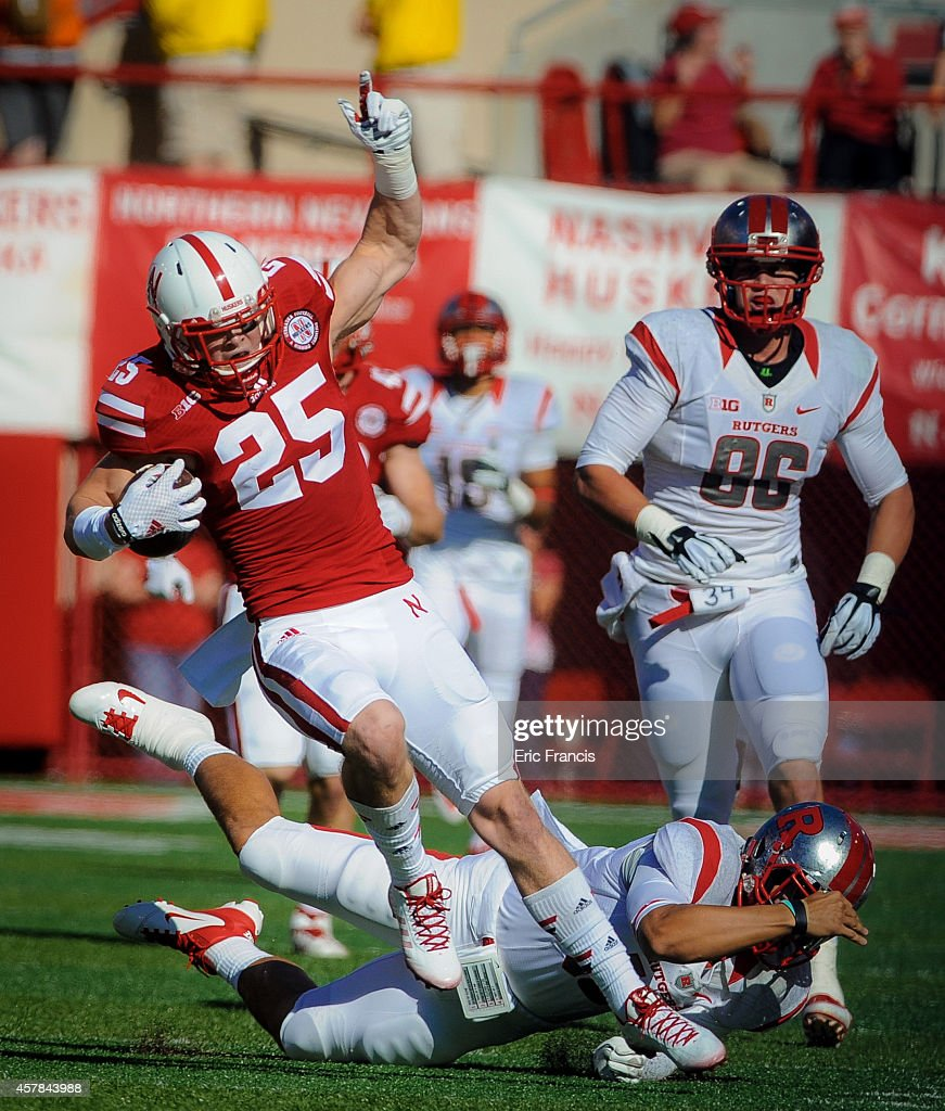 Defensive back Nate Gerry #25 of the Nebraska Cornhuskers returns an interception during their game against the Rutgers Scarlet Knights at Memorial Stadium on October 25, 2014 in Lincoln, Nebraska.