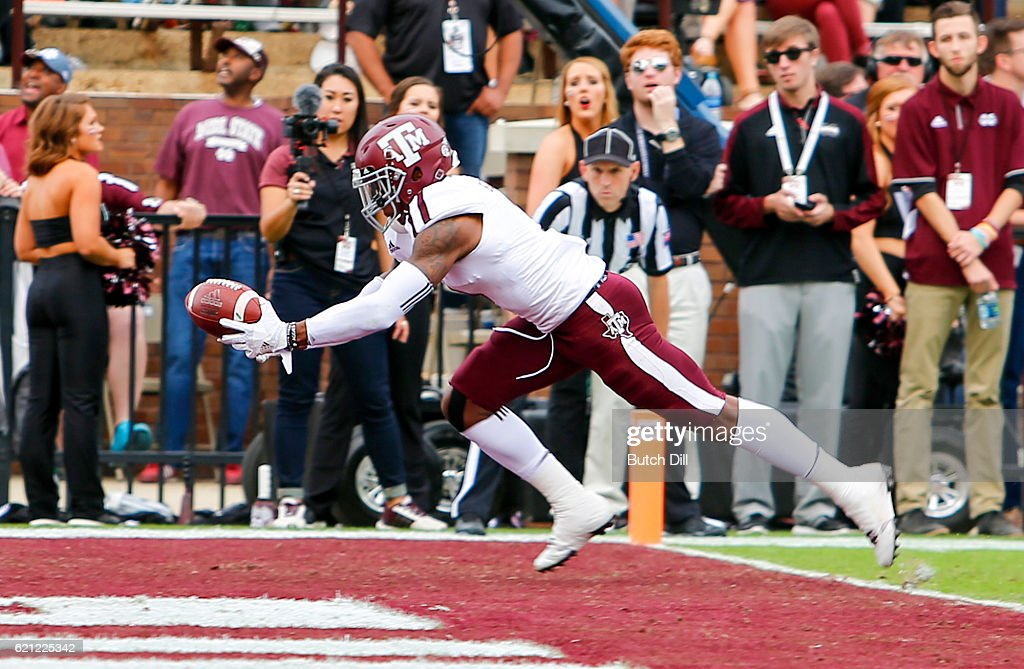 Defensive back Nick Harvey #1 of the Texas A&M Aggies intercepts a pass in the end zone during the first half of an NCAA college football game against the Mississippi State Bulldogs at Davis Wade Stadium on November 5, 2016 in Starkville, Mississippi.