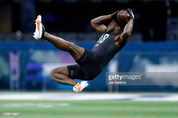 Defensive back Noah Igbinoghene of Auburn runs a drill during the NFL Combine at Lucas Oil Stadium on February 29 2020 in Indianapolis Indiana
