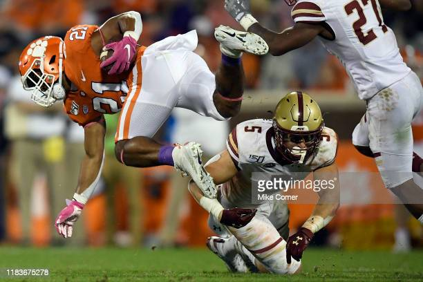 Defensive back Nolan Borgersen of the Boston College Eagles tackles running back Darien Rencher of the Clemson Tigers during their football game at...
