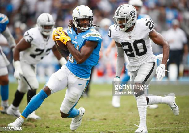 Defensive back Obi Melifonwu of the Oakland Raiders looks to tackle wide receiver Mike Williams of the Los Angeles Chargers in the third quarter at...