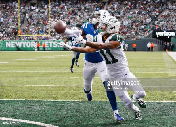 Defensive back Pierre Desir of the Indianapolis Colts breaks up a pass intended for wide receiver Robby Anderson of the New York Jets during the...