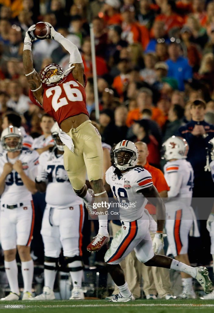 Defensive back P.J. Williams #26 of the Florida State Seminoles intercepts a pass in the fourth quarter against the Auburn Tigers during the 2014 Vizio BCS National Championship Game at the Rose Bowl on January 6, 2014 in Pasadena, California.