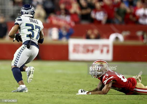 Defensive back Quandre Diggs of the Seattle Seahawks intercepts the ball intended for wide receiver Kendrick Bourne of the San Francisco 49ers during...