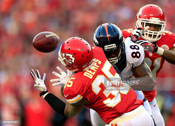 Defensive back Quintin Demps of the Kansas City Chiefs intercepts a pass intended for wide receiver Demaryius Thomas of the Denver Broncos during the...