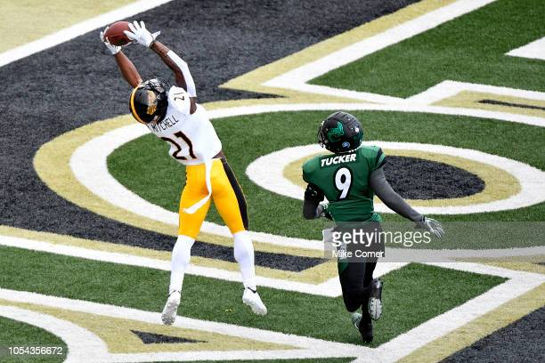 Defensive back Rachuan Mitchell of the Southern Miss Golden Eagles intercepts a pass intended for wide receiver Victor Tucker of the Charlotte 49ers...