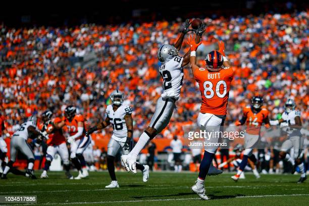 Defensive back Rashaan Melvin of the Oakland Raiders intercepts a pass intended for tight end Jake Butt of the Denver Broncos at Broncos Stadium at...