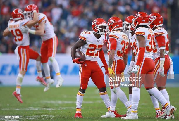 Defensive back Rashad Fenton of the Kansas City Chiefs and teammates celebrate an interception in the fourth quarter over the Los Angeles Chargers at...
