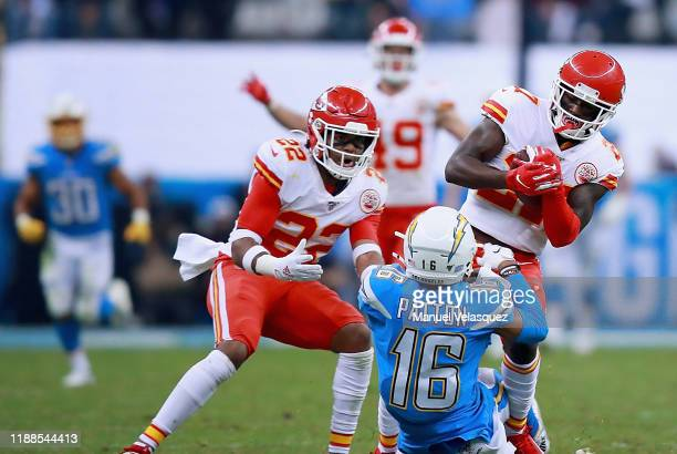 Defensive back Rashad Fenton of the Kansas City Chiefs intercepts a pass intended for wide receiver Andre Patton of the Los Angeles Chargers in the...