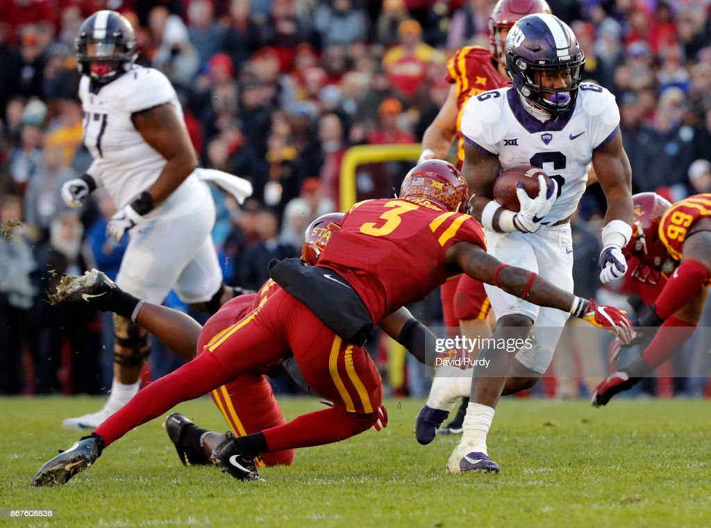 Defensive back Reggie Wilkerson #3 of the Iowa State Cyclones tackles running back Darius Anderson #6 of the TCU Horned Frogs as he rushed for yard in the second half of play at Jack Trice Stadium on October 28, 2017 in Ames, Iowa. The Iowa State Cyclones won 14-7 over the TCU Horned Frogs.