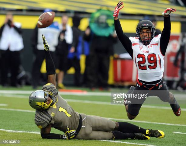 Defensive back Reginald Porter of the Utah Utes is called for interference as he trips up wide receiver Josh Huff of the Oregon Ducks during the...
