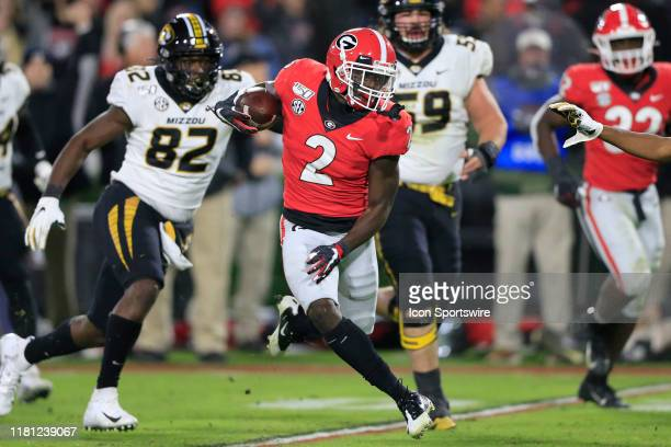 Defensive back Richard LeCounte of the Georgia Bulldogs runs back an interception during the college football game between the Georgia Bulldogs and...