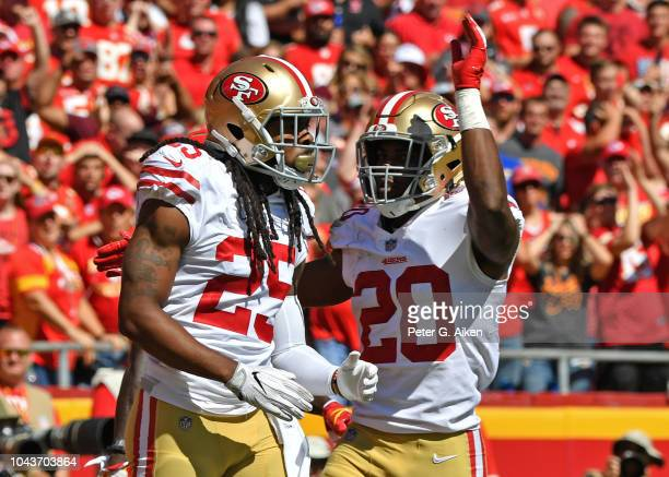 Defensive back Richard Sherman of the San Francisco 49ers reacts after braking up a pass play with defensive back Jimmie Ward, against the Kansas...