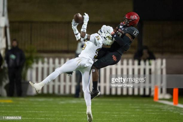 Defensive back Rishard Dames of the FIU Golden Panthers intercepts the ball intended for wide receiver Kirk Merritt of the Arkansas State Red Wolves...