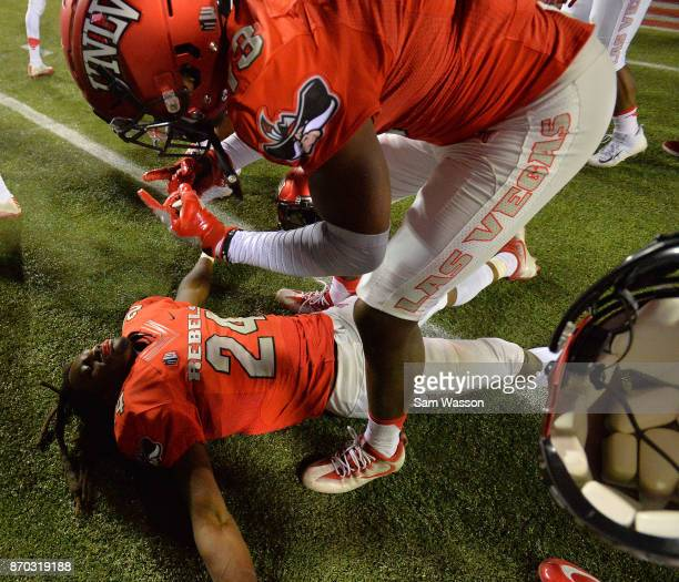 Defensive back Robert Jackson is congratulated by defensive back Tim Hough of the UNLV Rebels after their game against the Hawaii Warriors at Sam...