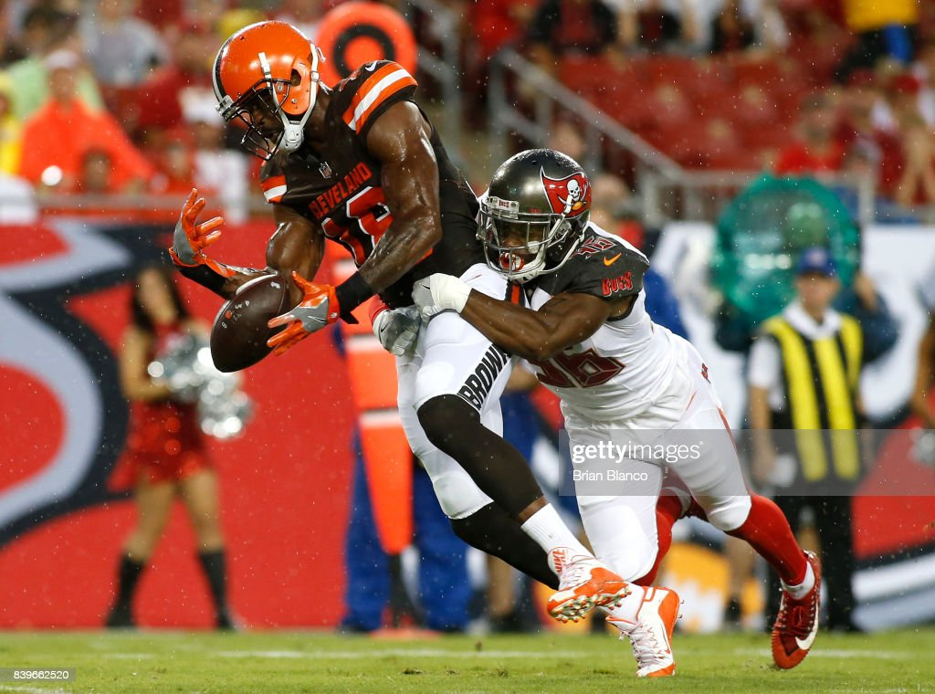Defensive back Robert McClain #36 of the Tampa Bay Buccaneers breaks up a pass intended for wide receiver Kenny Britt #18 of the Cleveland Browns during the first quarter of an NFL preseason football game on August 26, 2017 at Raymond James Stadium in Tampa, Florida.