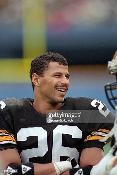 Defensive back Rod Woodson of the Pittsburgh Steelers smiles while talking to teammates on the sideline during a game against the New Orleans Saints...