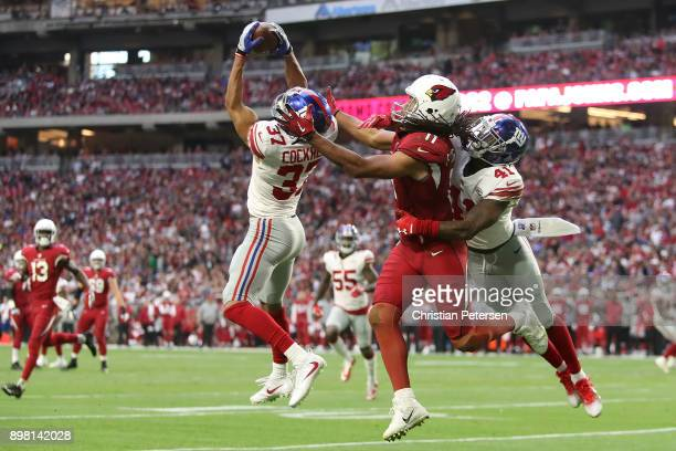 Defensive back Ross Cockrell of the New York Giants intercepts a pass intended for wide receiver Larry Fitzgerald of the Arizona Cardinals in the...