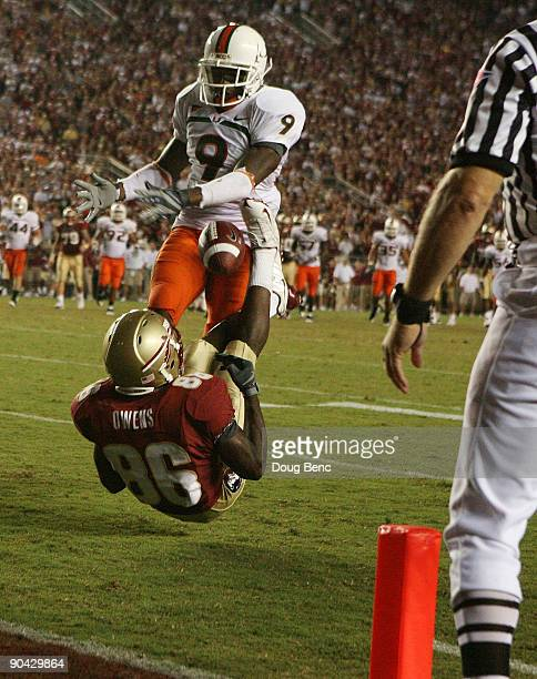 Defensive back Sam Shields of the Miami Hurricanes knocks the ball away from wide receiver Rod Owens of the Florida State Seminoles during a goal...
