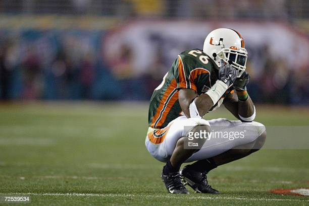 Defensive back Sean Taylor of the Miami Hurricanes sits dejected after being stripped of an interception by running back Maurice Clarett of the Ohio...