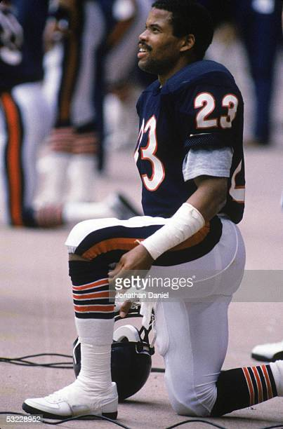 Defensive back Shaun Gayle of the Chicago Bears takes a rest on the sidelines during a game in the 1985 season at Soldier Field in Chicago Illinois