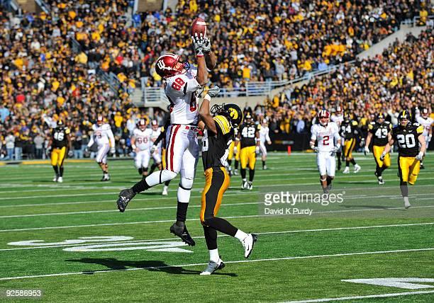 Defensive back Shaun Prater of the Iowa Hawkeyes defends as wide receiver Damarlo Belcher of the Indian Hoosiers catches a pass near the 20 yard line...
