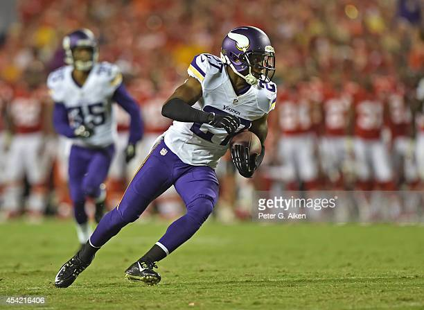 Defensive back Shaun Prater of the Minnesota Vikings returns an interception against the Kansas City Chiefs during the second half on August 23, 2014...