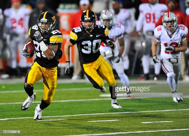 Defensive back Shaun Prater of the University of Iowa Hawkeyes returns a pass interception against the Ohio State Buckeyes during the second half of...