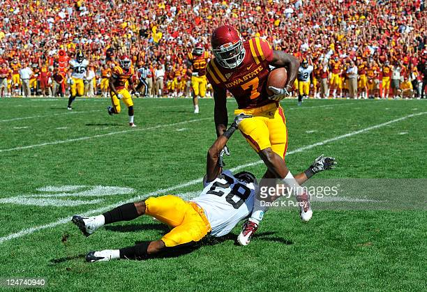 Defensive back Shaun Prater of the University of Iowa Hawkeyes tackles wide receiver Darius Reynolds of the of the Iowa State Cyclones in the second...