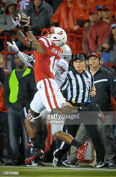 Defensive back Stanley Jean-Baptiste of the Nebraska Cornhuskers pulls in a late game interception from wide receiver Corey Brown of the Ohio State...