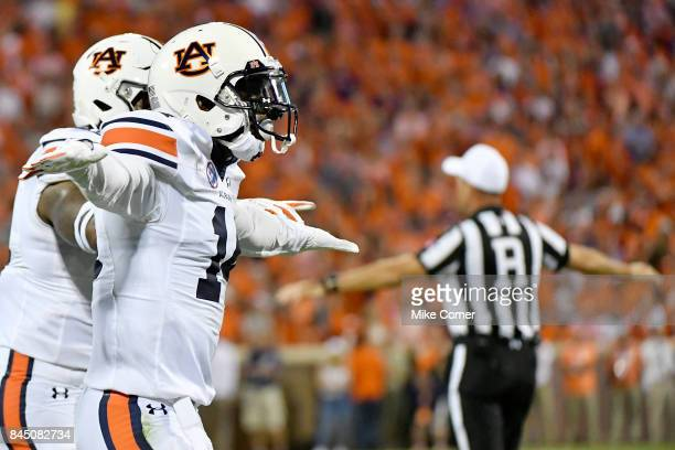 Defensive back Stephen Roberts and linebacker Darrell Williams of the Auburn Tigers celebrate following a stop against the Clemson Tigers during the...
