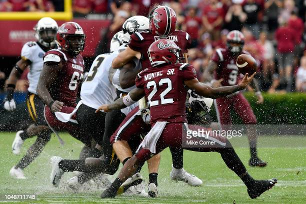Defensive back Steven Montac of the South Carolina Gamecocks juggles a loose ball against the Missouri Tigers during the football game at...