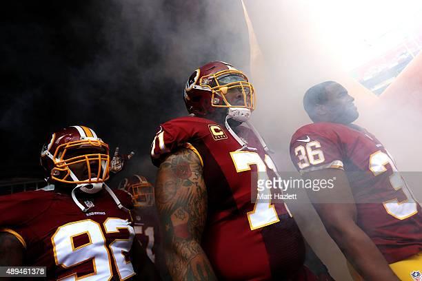 Defensive back Tanard Jackson of the Washington Redskins, nose tackle Chris Baker of the Washington Redskins, inside linebacker Will Compton of the...