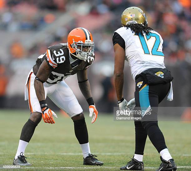 Defensive back Tashaun Gipson of the Cleveland Browns lines up to guard receiver Mike Brown of the Jacksonville Jaguars during a game against the...