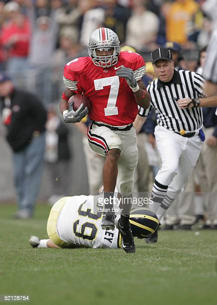 Defensive back Ted Ginn Jr #7 of the Ohio State University Buckeyes returns a punt against the University of Michigan Wolverines during the game on...