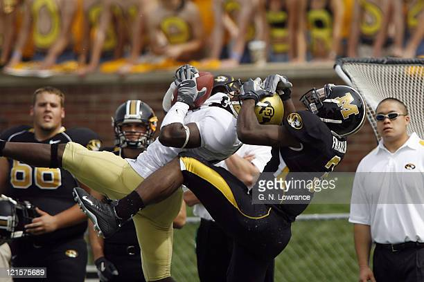 Defensive back Terrance Wheatley of Colorado makes an apparent interception as Will Franklin makes the tackle during action between the Colorado...