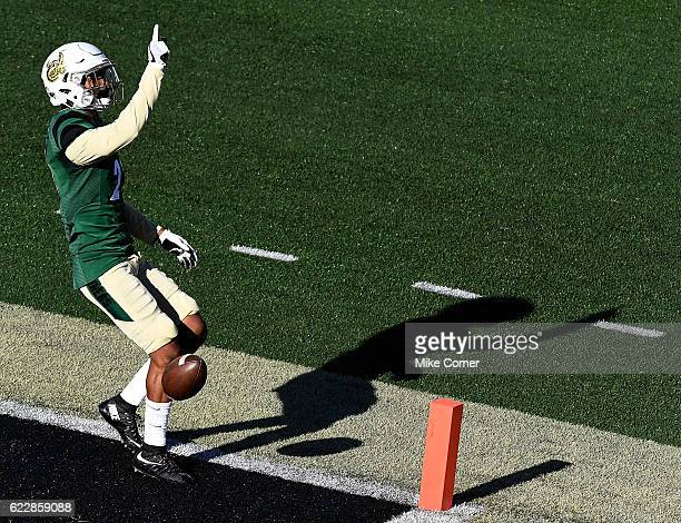 Defensive back Terrance Winchester of the Charlotte 49ers celebrates after running back an interception for a touchdown against the Rice Owls at...