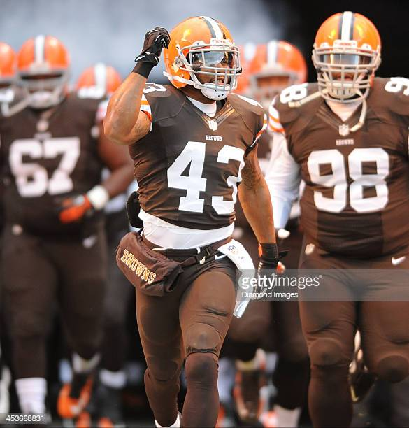 Defensive back TJ Ward of the Cleveland Browns runs onto the field during pre game introductions before a game against the Pittsburgh Steelers at...
